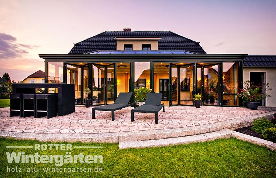Wintergarten Holz Alu Orangerie große Faltanlage Beleuchtung